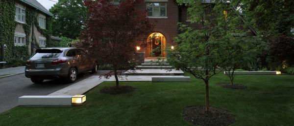 View of the front garden at night (photo: Peter Legris Photography)