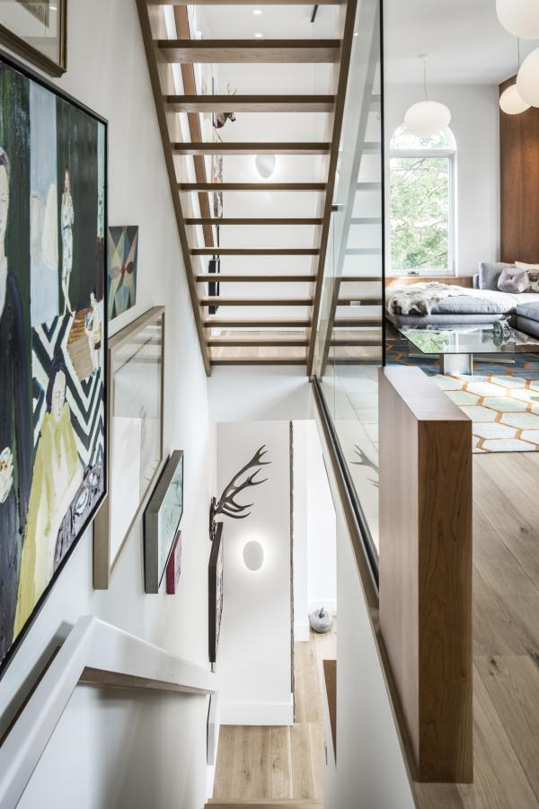 Open stair spills light to the second floor (photo: Steven Evans Photography)