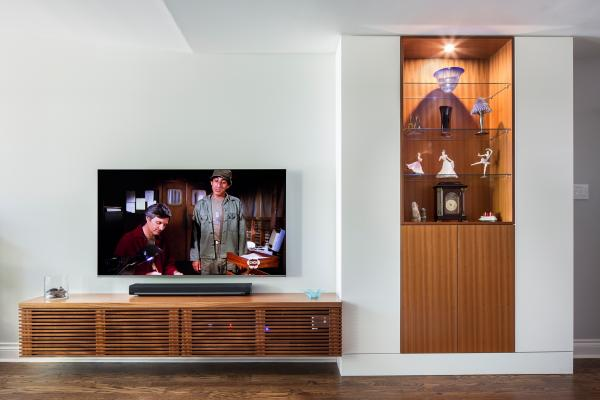 Custom cabinets orgaize 'stuff' and wall bumps (photo: Steven Evans Photography)