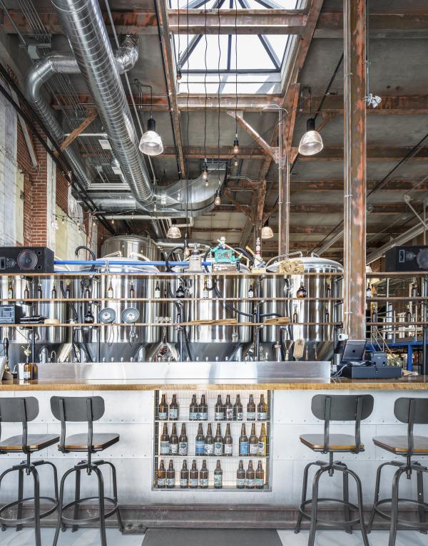 The taproom overlooking the production area (photo: Steven Evans Photography)