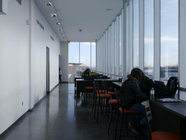 Interior view with students avoiding glare before